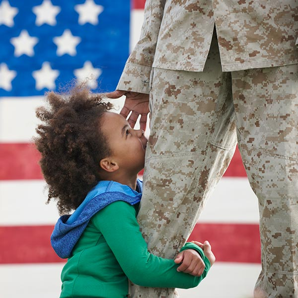 child hugging her veteran parent